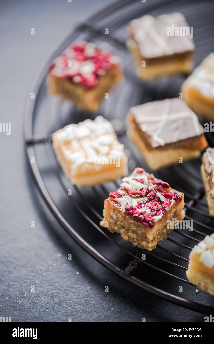 Oat brownie bites on cooling tray, dieting concept with healthy sweets Stock Photo