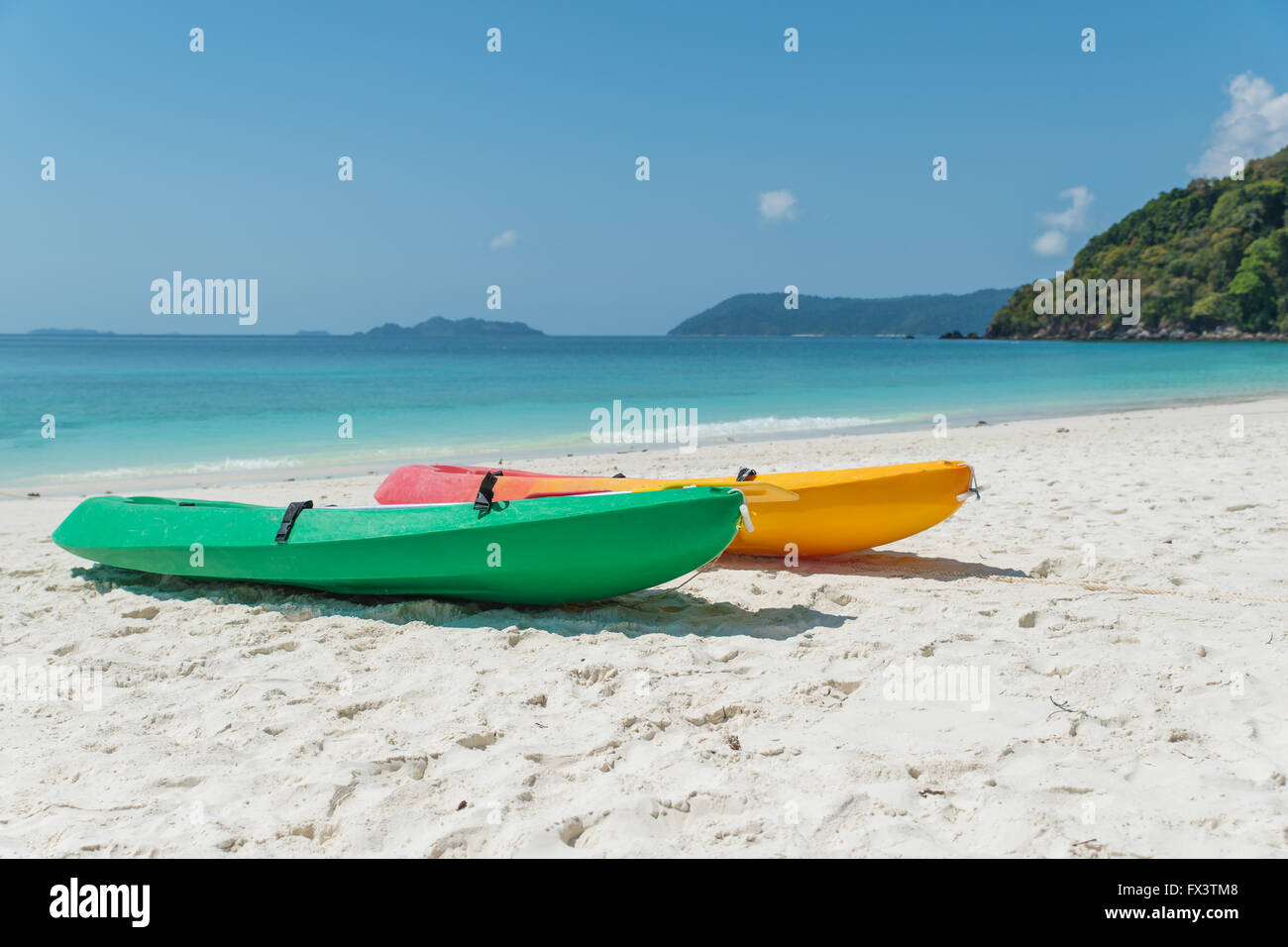 Summer, Travel, Vacation and Holiday concept - Colorful kayaks on the tropical beach, Thailand Stock Photo