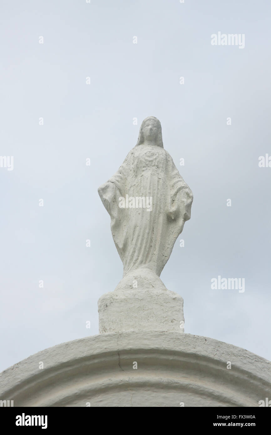 Weathered, white statue, in a cemetery, New Orleans, Louisiana. - Stock Image