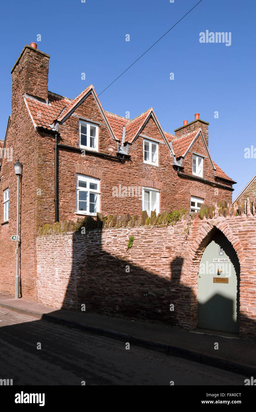 Substantial historic house in the village of Iron Acton, South Gloucestershire, built of red Pennant sandstone, - Stock Image