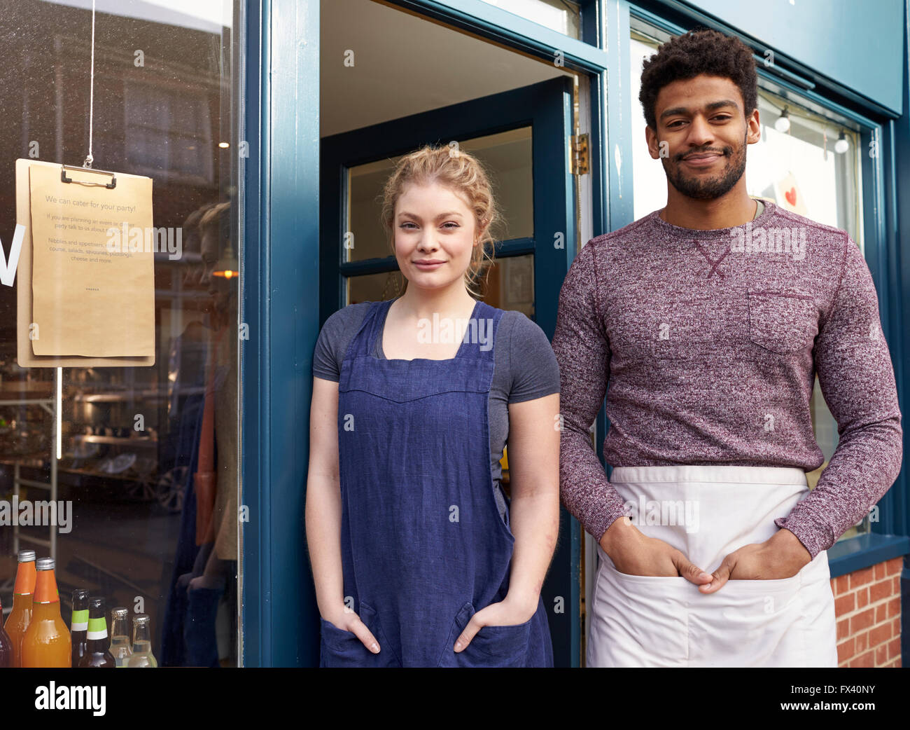 Portrait Of Delicatessen Staff Standing Outside Shop - Stock Image