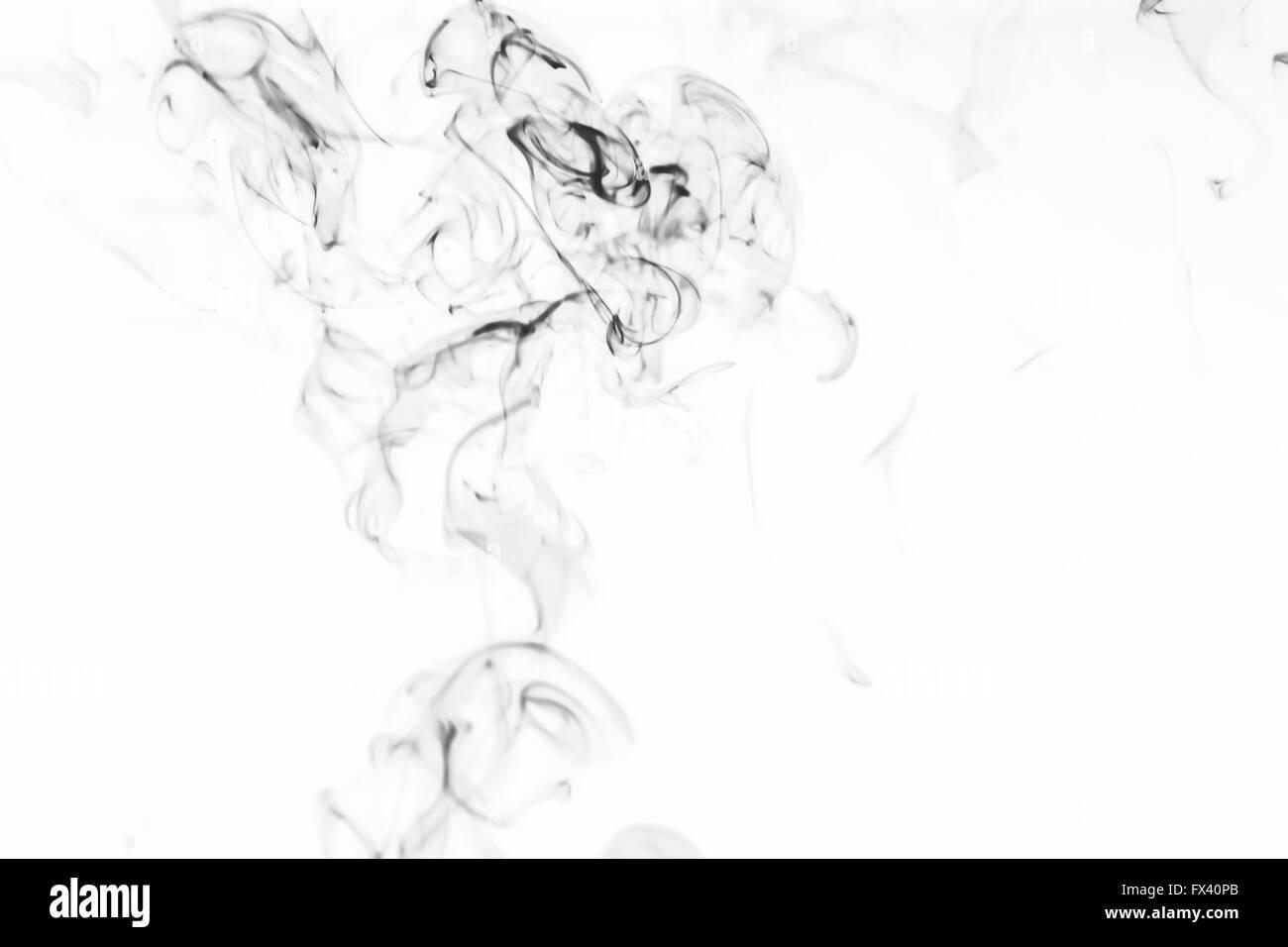 Silhouette is similar to smoke on white - Stock Image