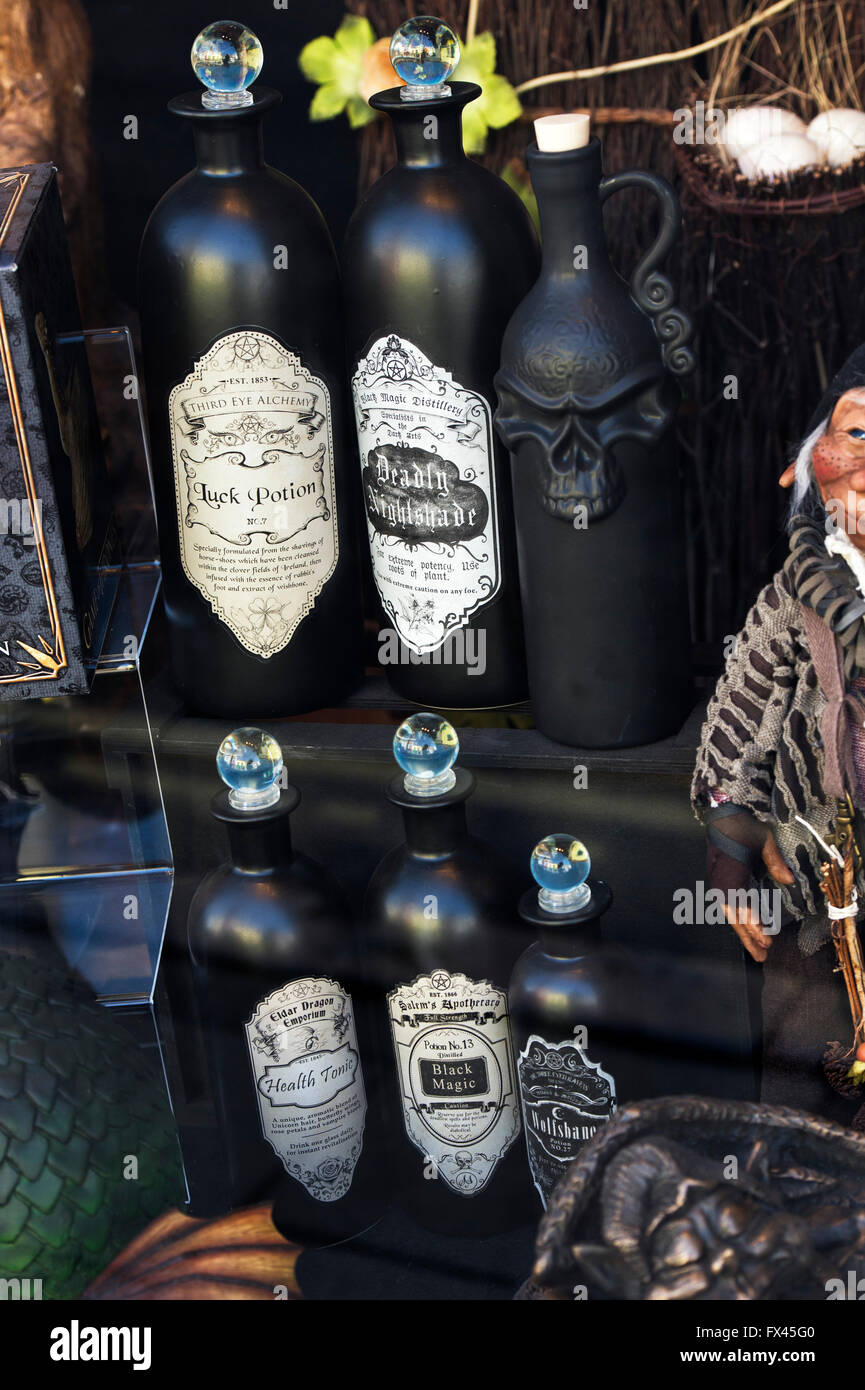 Potion and tonic bottles in a shop window. Glastonbury, Somerset, England - Stock Image