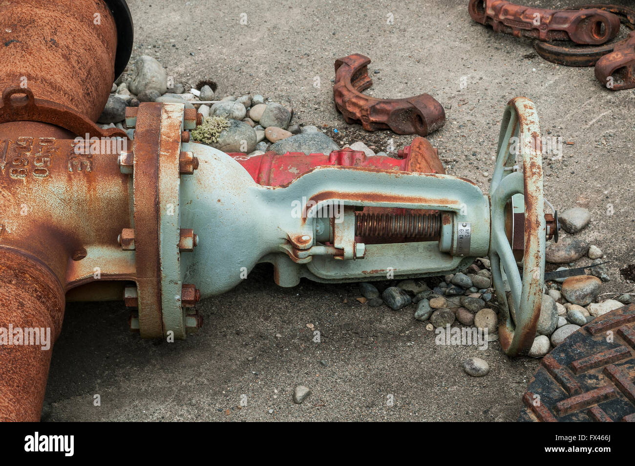 Gate valve laying on ground at Satsop Development Park in Western Washington State. - Stock Image