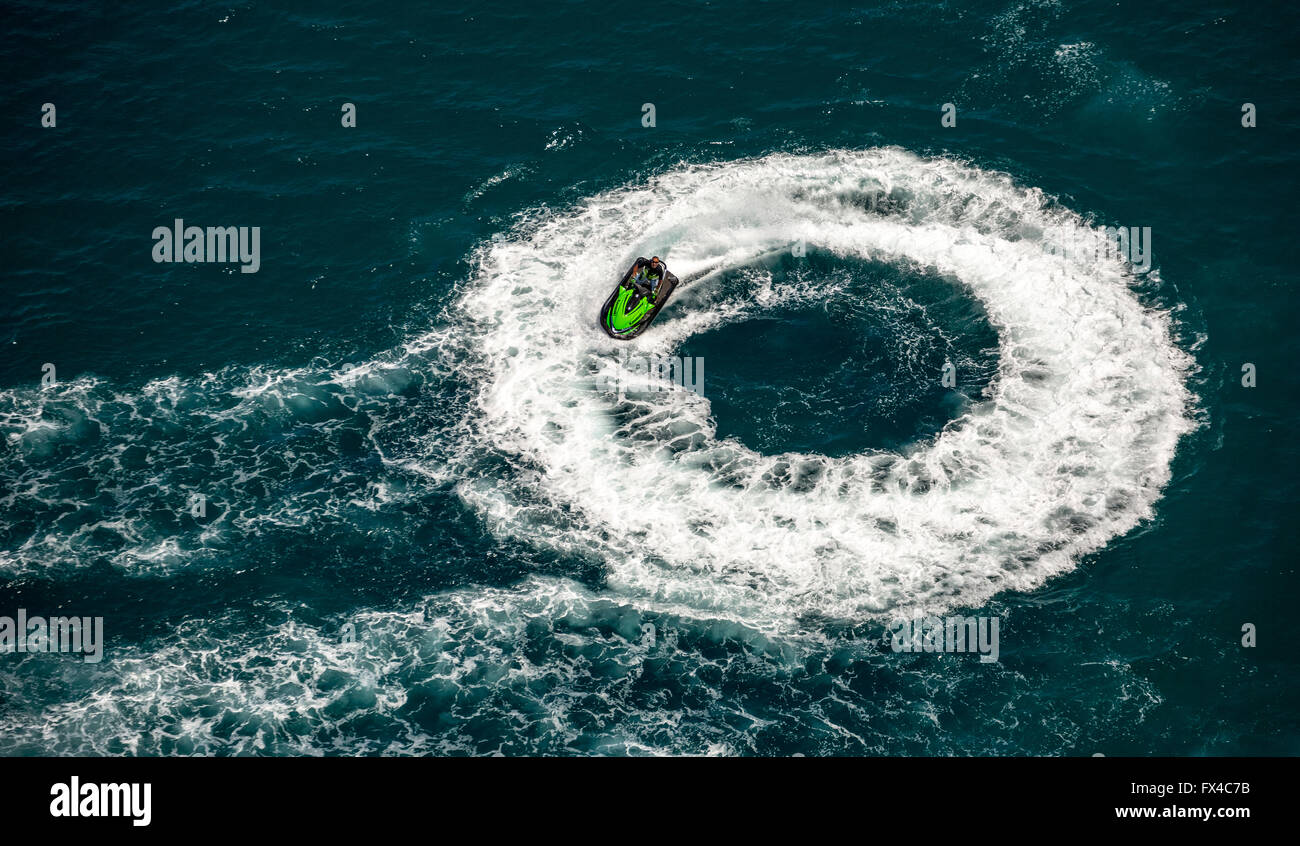 Aerial view, jet moves in a circle, circle drive, green jet skiing, Jetski on the Mediterranean Sea at Leucate, - Stock Image
