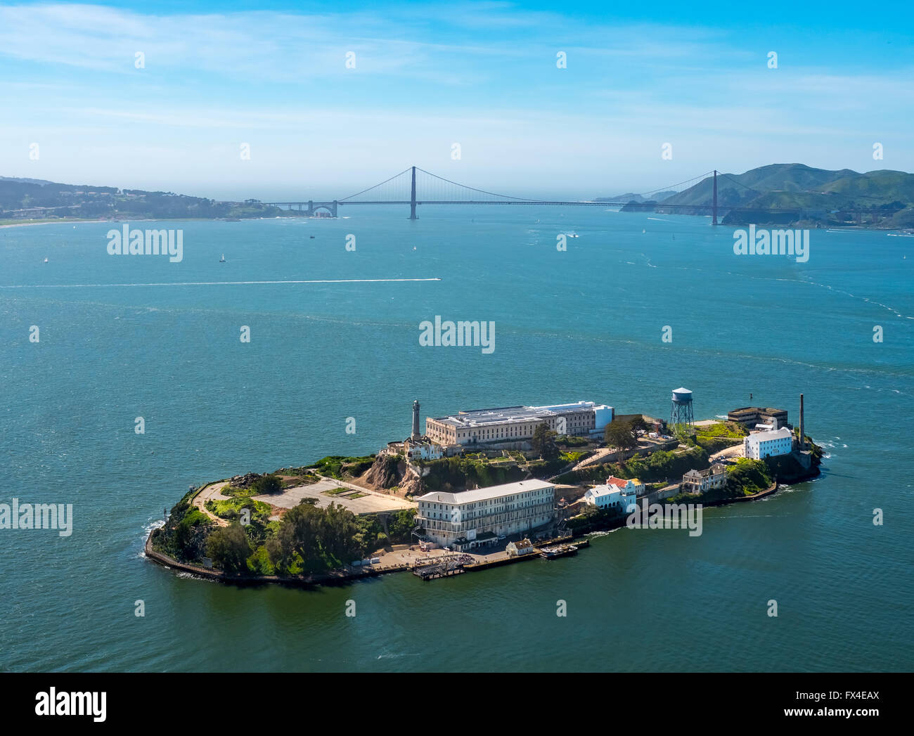 Aerial view, Alcatraz, Golden Gate Bridge in the background, Alcatraz Iceland with lighthouse in backlight, San - Stock Image