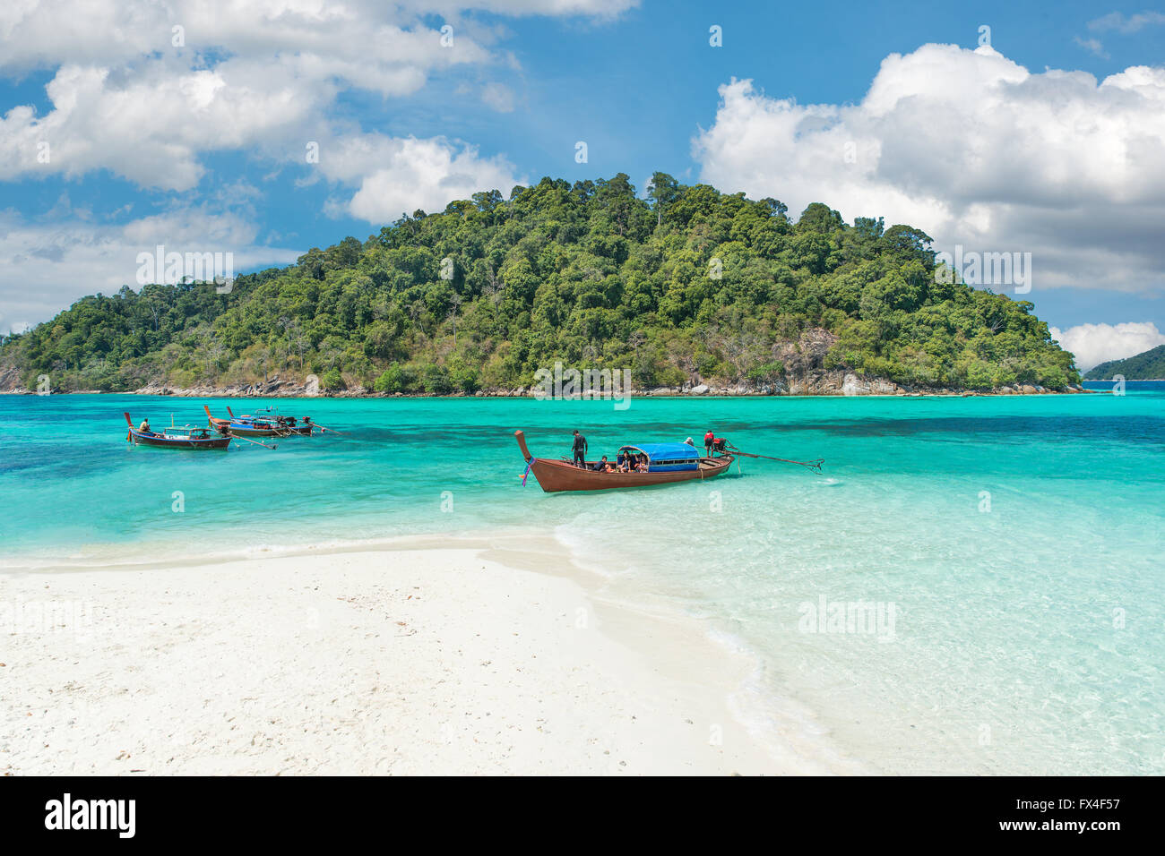 Summer, Travel, Vacation and Holiday concept - Longtale boats at the beautiful beach, Thailand - Stock Image
