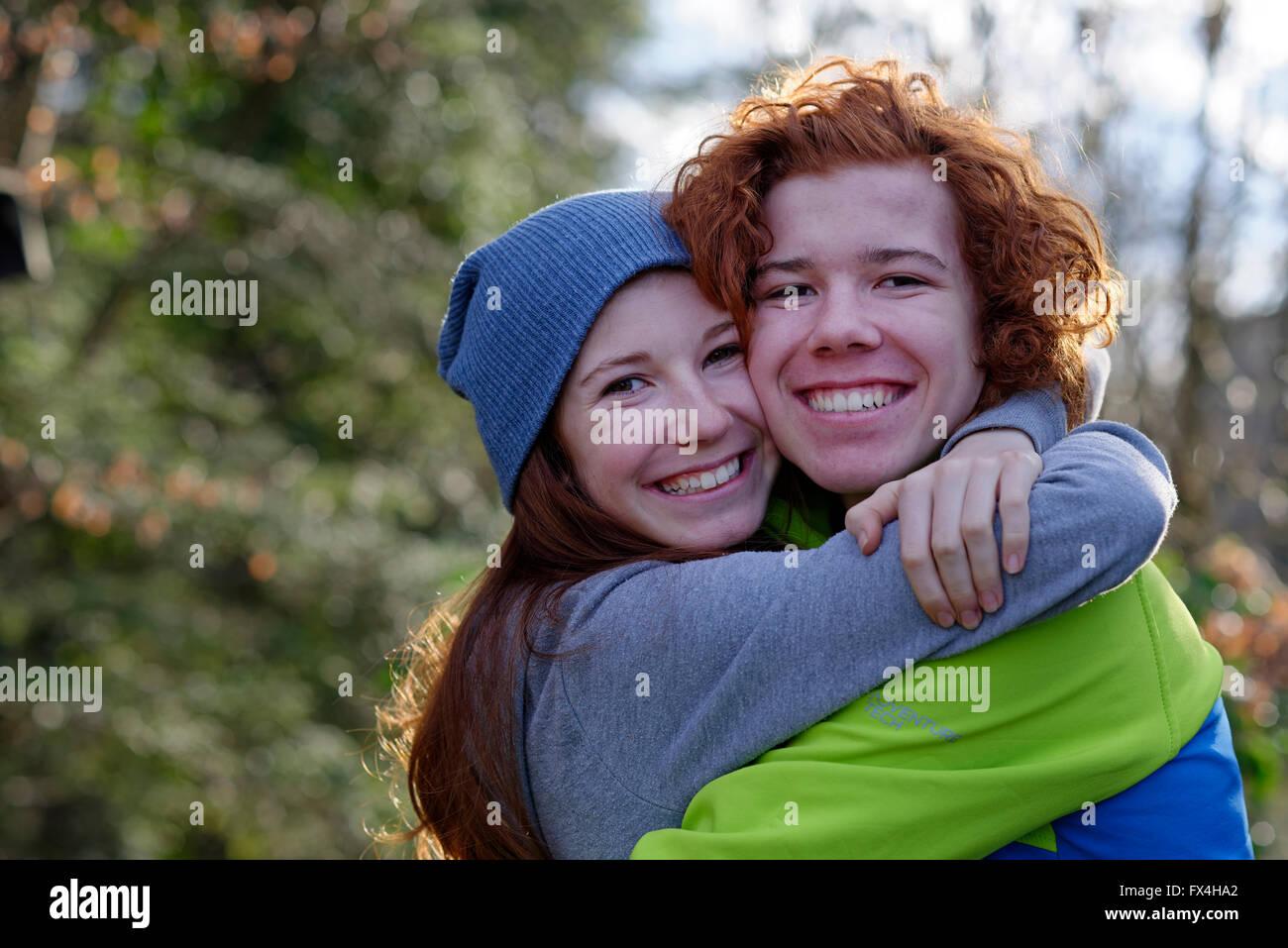 brother and sister hugging redheaded siblings sibling s love stock