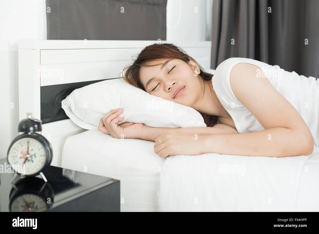 Asian beautiful girl sleeping in the bedroom at home - Stock Image