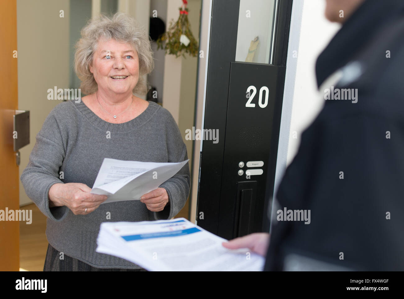 Hanover, Germany. 11th Apr, 2016. A woman receives a sheet containing instructions on the visit of US President Stock Photo