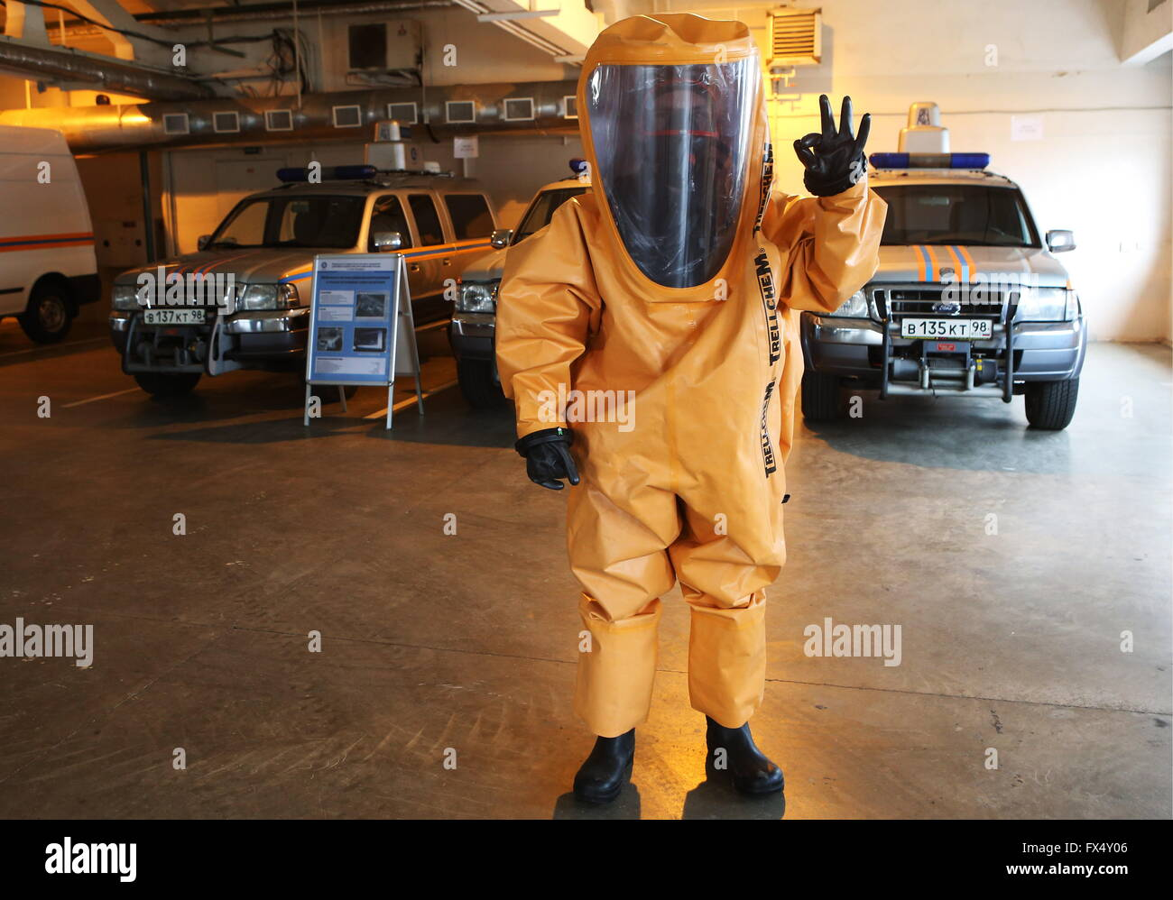 ST. PETERSBURG, RUSSIA. APRIL 6, 2016. Rosatom Emergency Service worker in a hazmat suit shows an OK gesture before - Stock Image