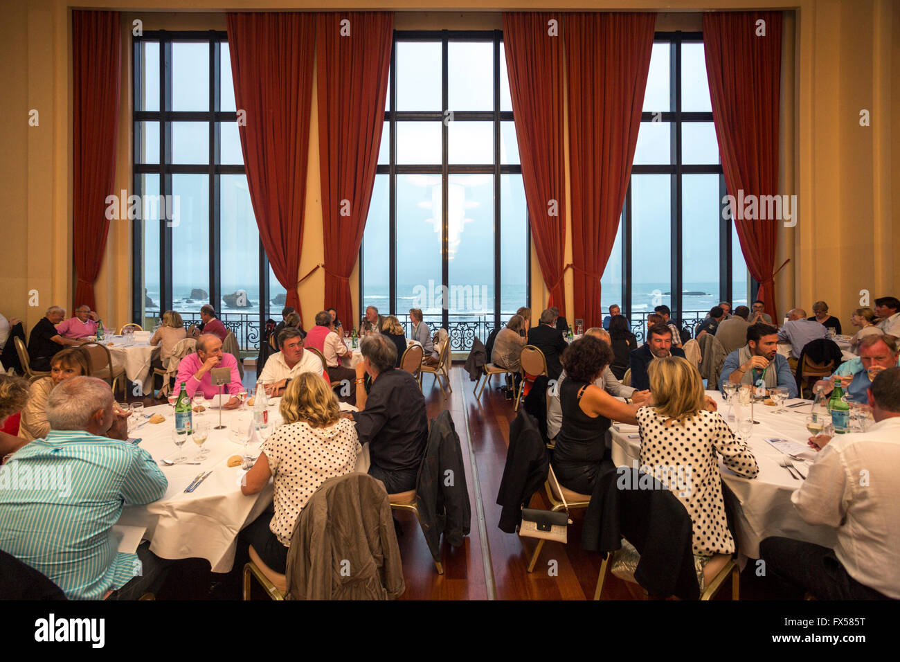 A reception in the ambassador function room of the Biarritz municipal casino (France). Picture windows which open - Stock Image