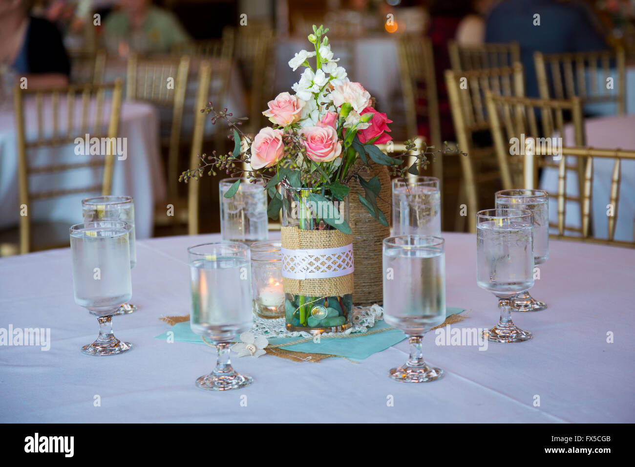 DIY wedding decor table centerpieces with wine bottles wrapped in ...