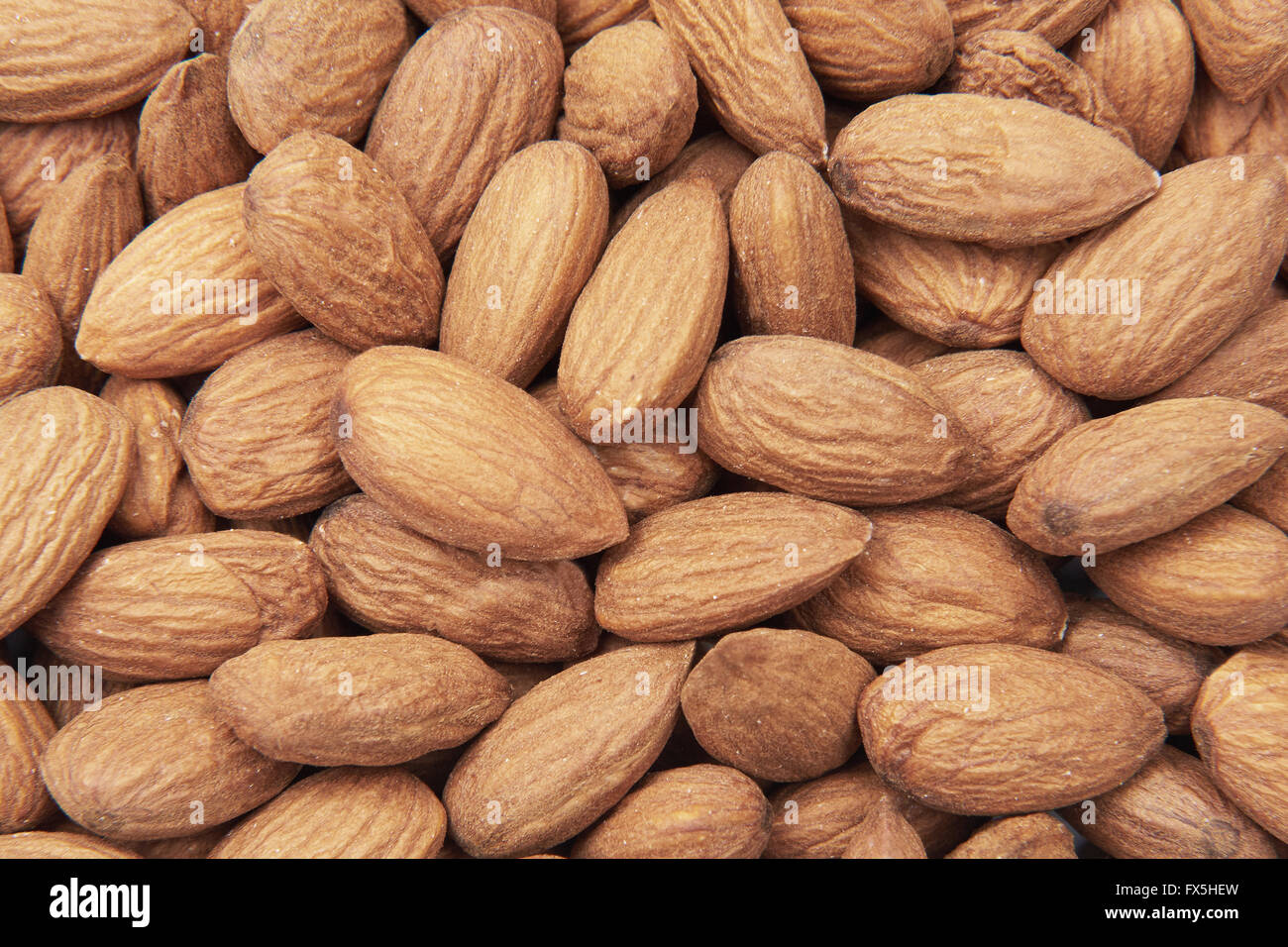 Closeup image of ecological unshelled almonds - Stock Image
