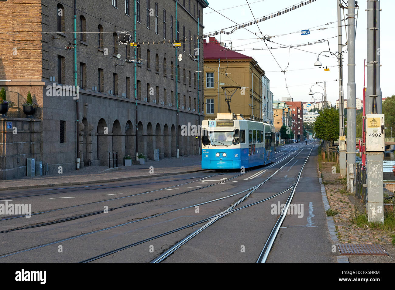 Street view in Gothenburg, Sweden with a blue tram driving - Stock Image