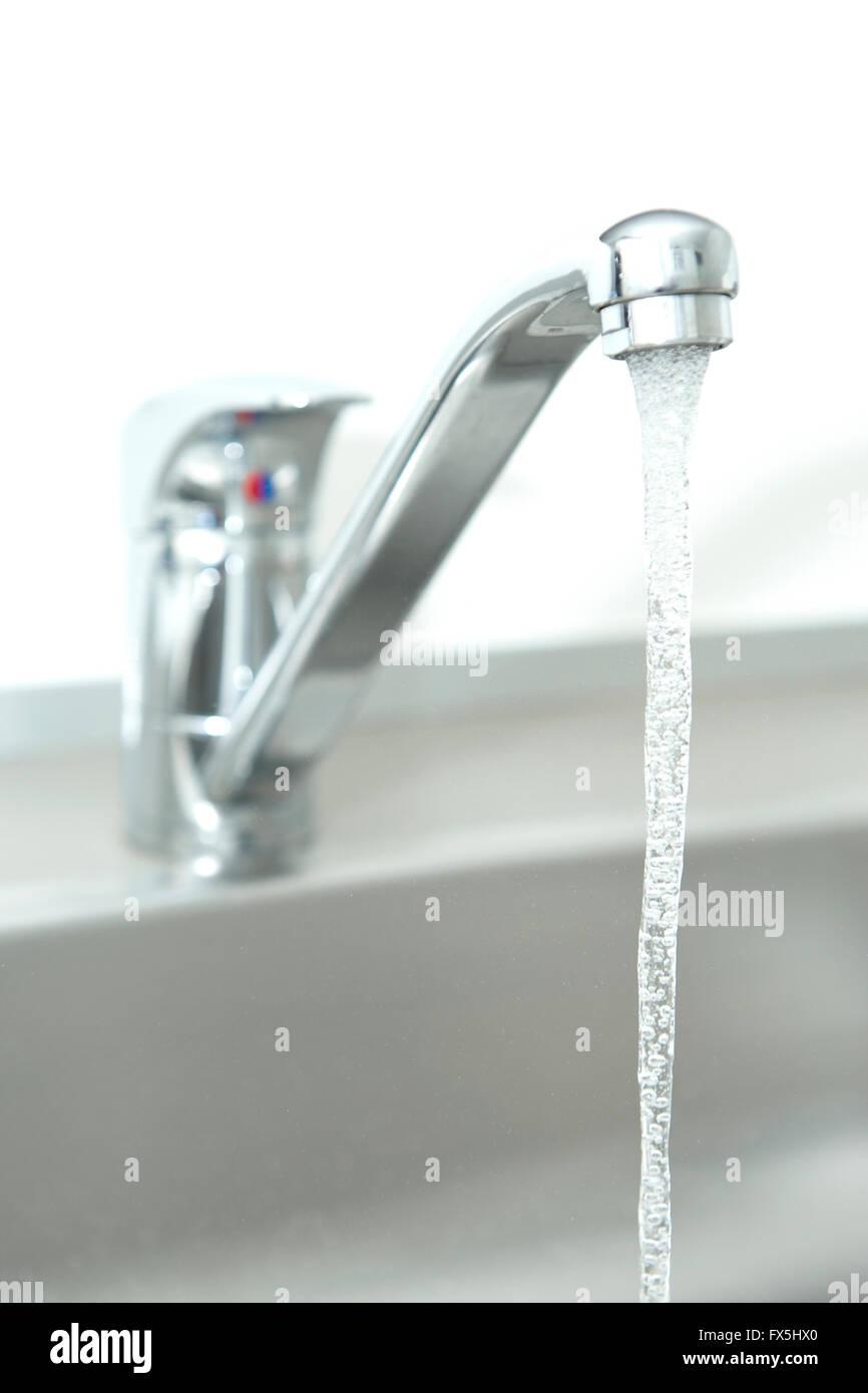 Closeup shoot of a running water tap - Stock Image