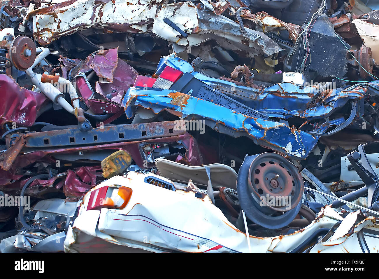 Junkyard metal in a big pile and different colors - Stock Image