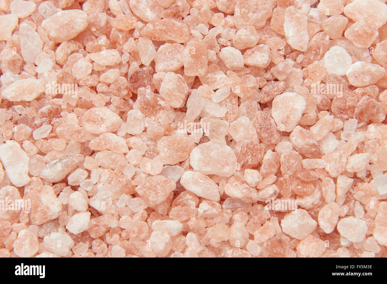 Closeup image of pink Himalayan salt crystals - Stock Image