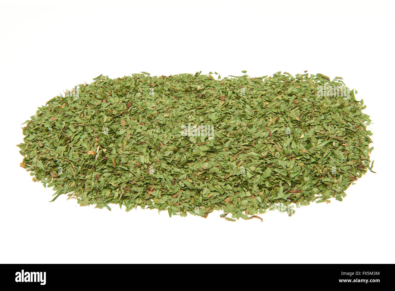 Closeup image of green dried tarragon leaves - Stock Image