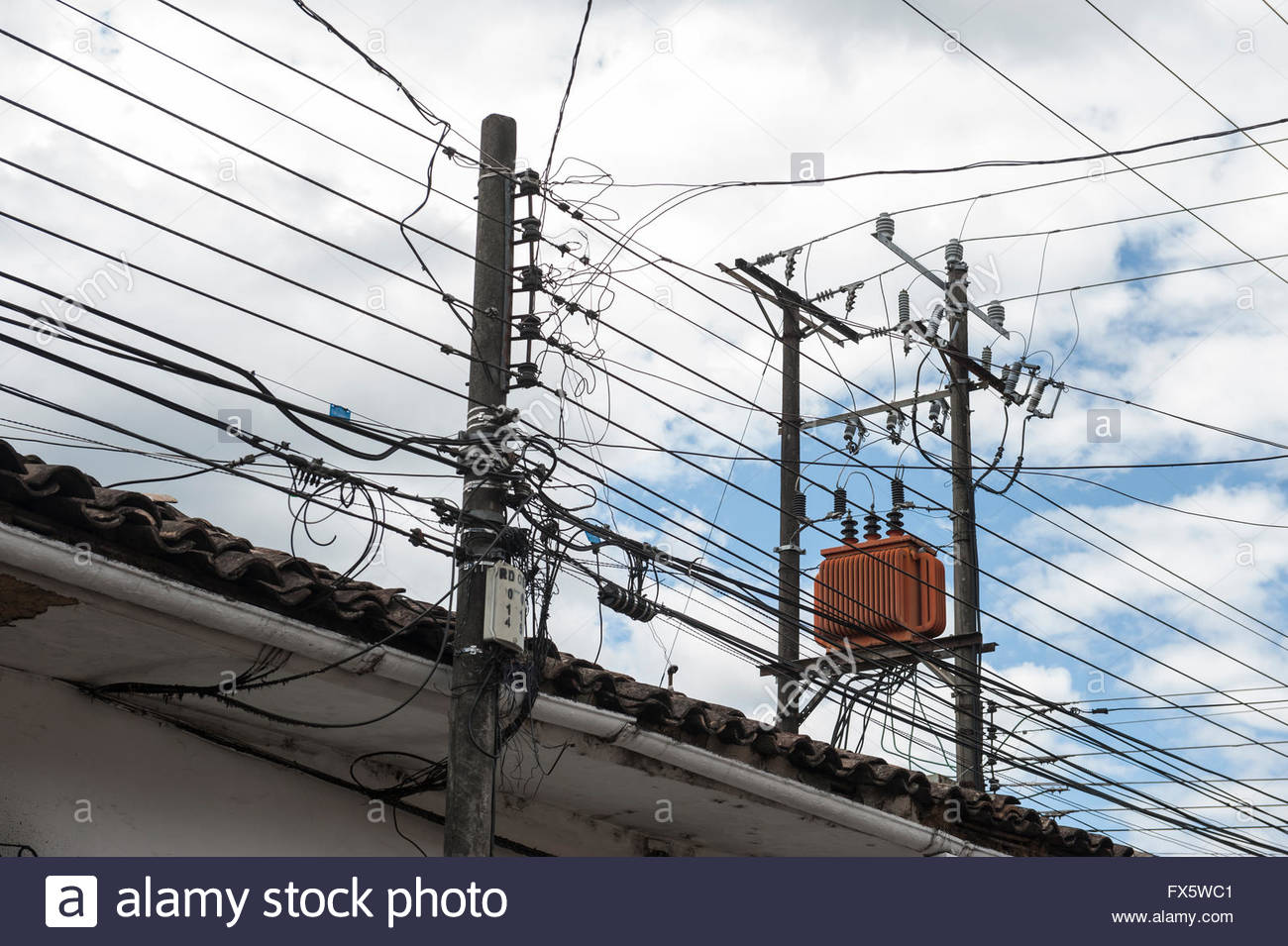 Popayan Colombia Wirwar of telephone and electricty cables above the houses. - Stock Image
