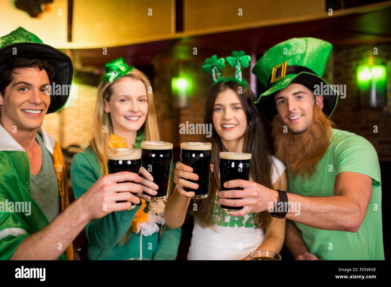 Smiling friends with Irish accessory - Stock Image