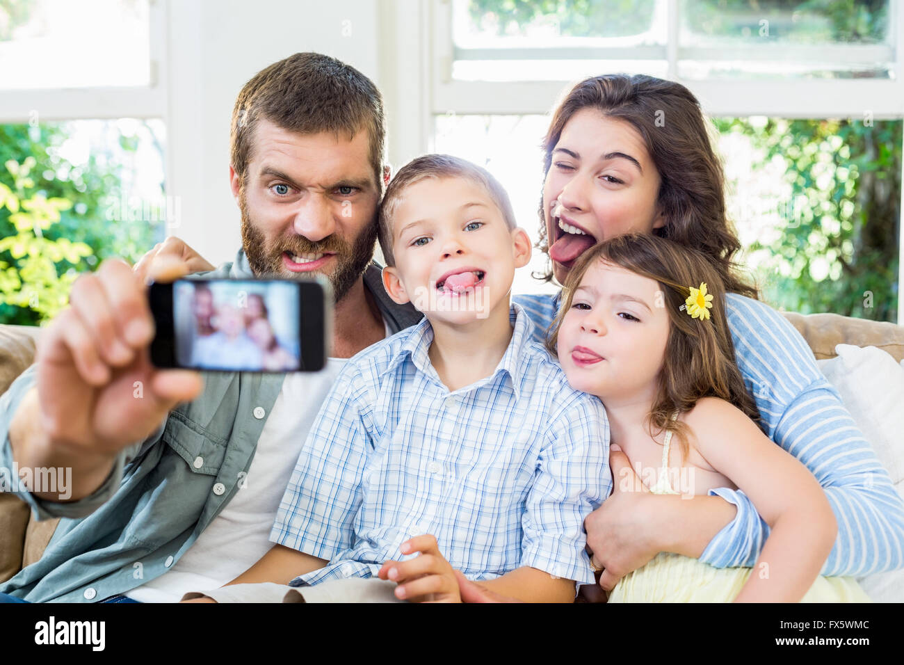 Happy family taking a selfie - Stock Image