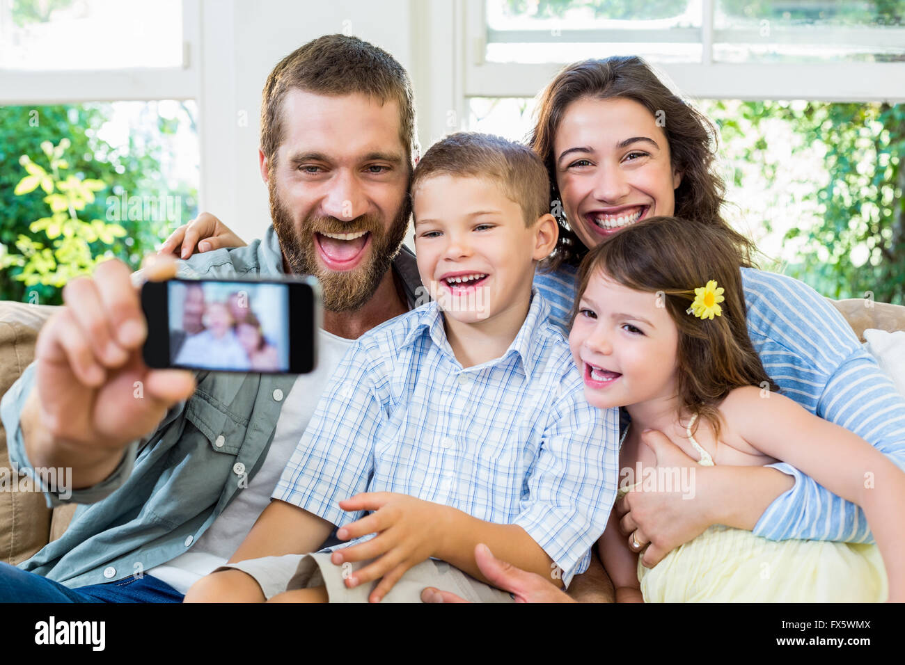 Smiling family taking selfie Stock Photo