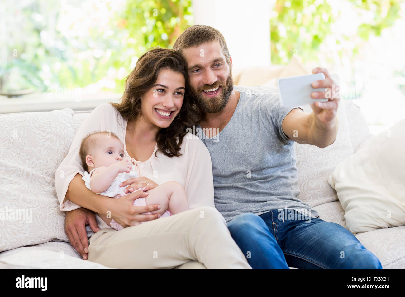 Family taking selfie on a mobile phone - Stock Image