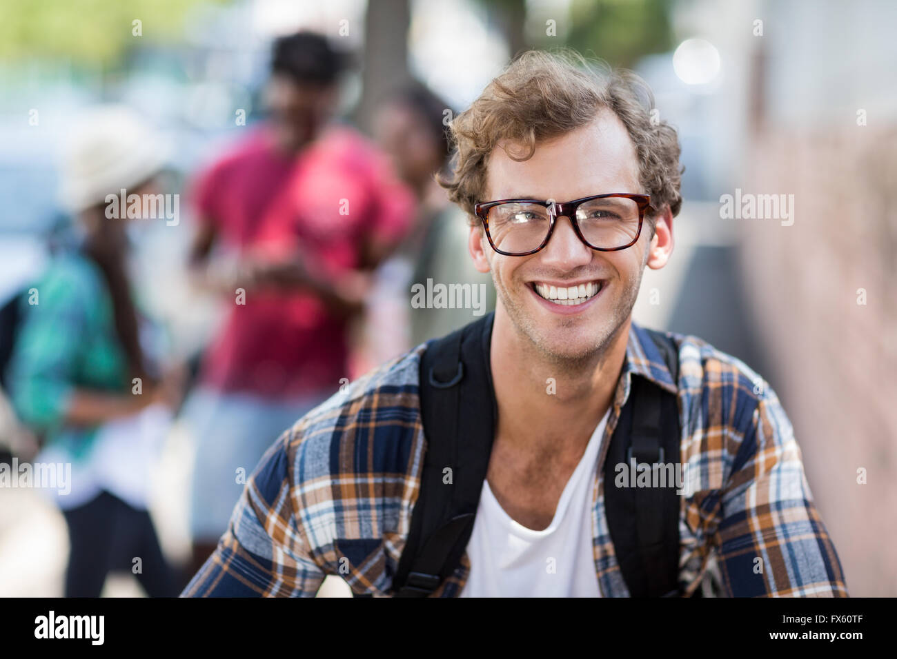 Portrait of young man smiling - Stock Image