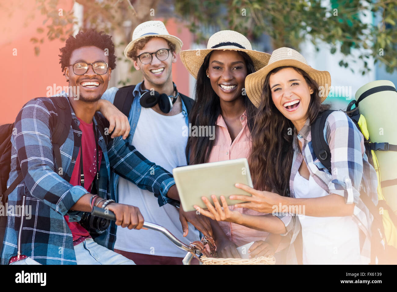 Friends using digital tablet - Stock Image