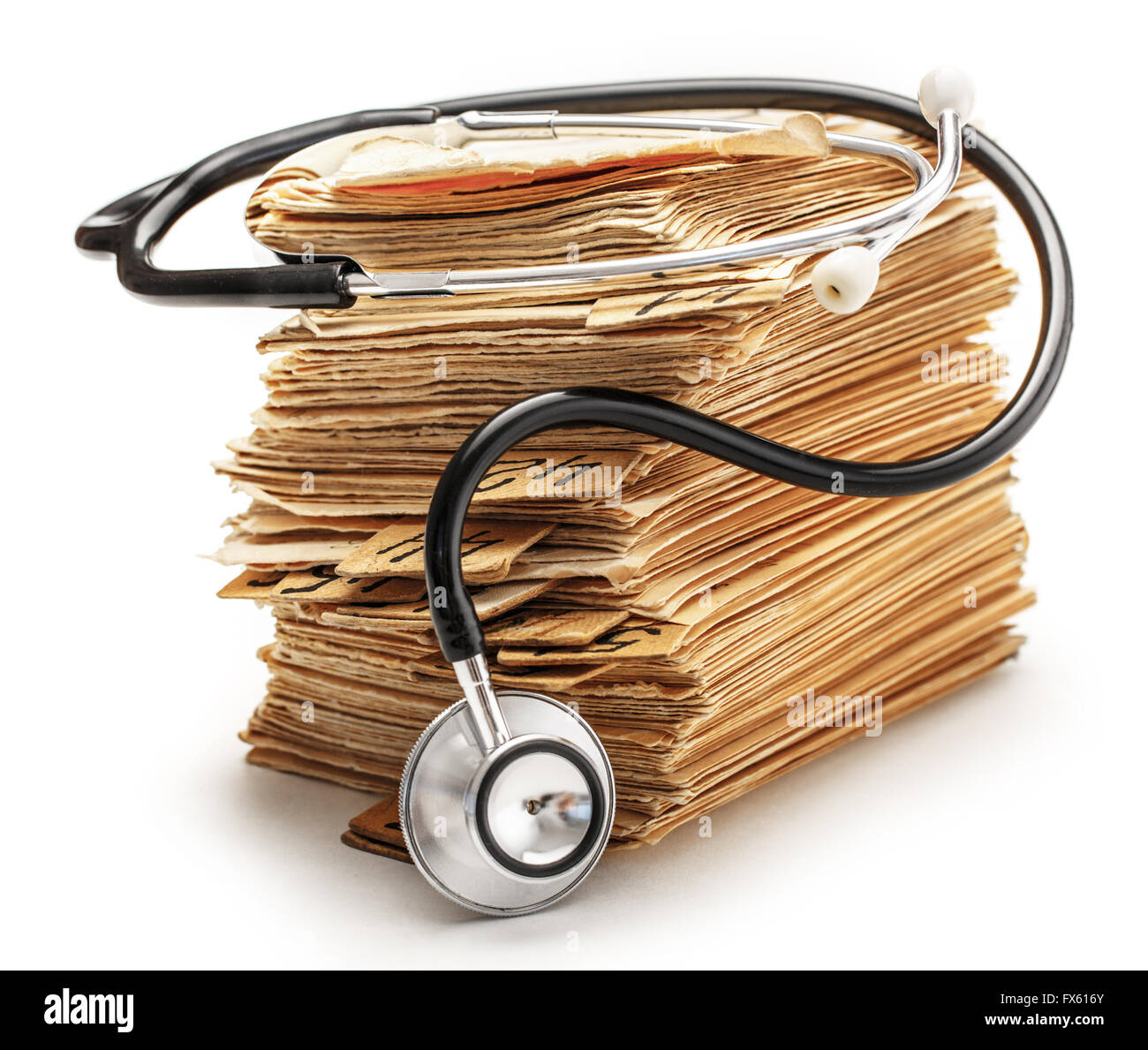 Pile of old cards with stethoscope in closeup - Stock Image