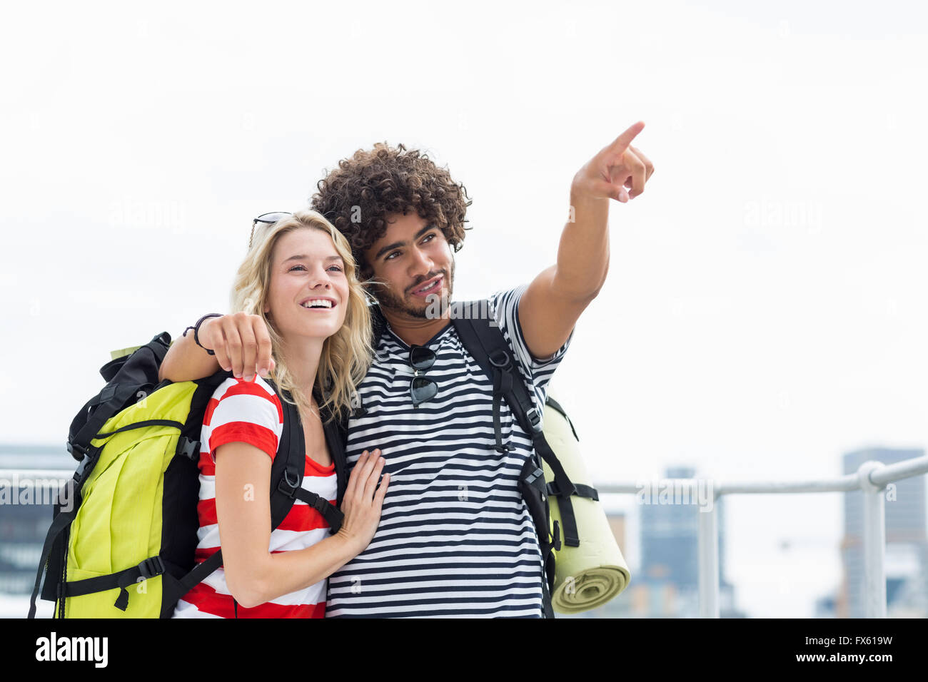 Man standing with woman pointing upwards - Stock Image