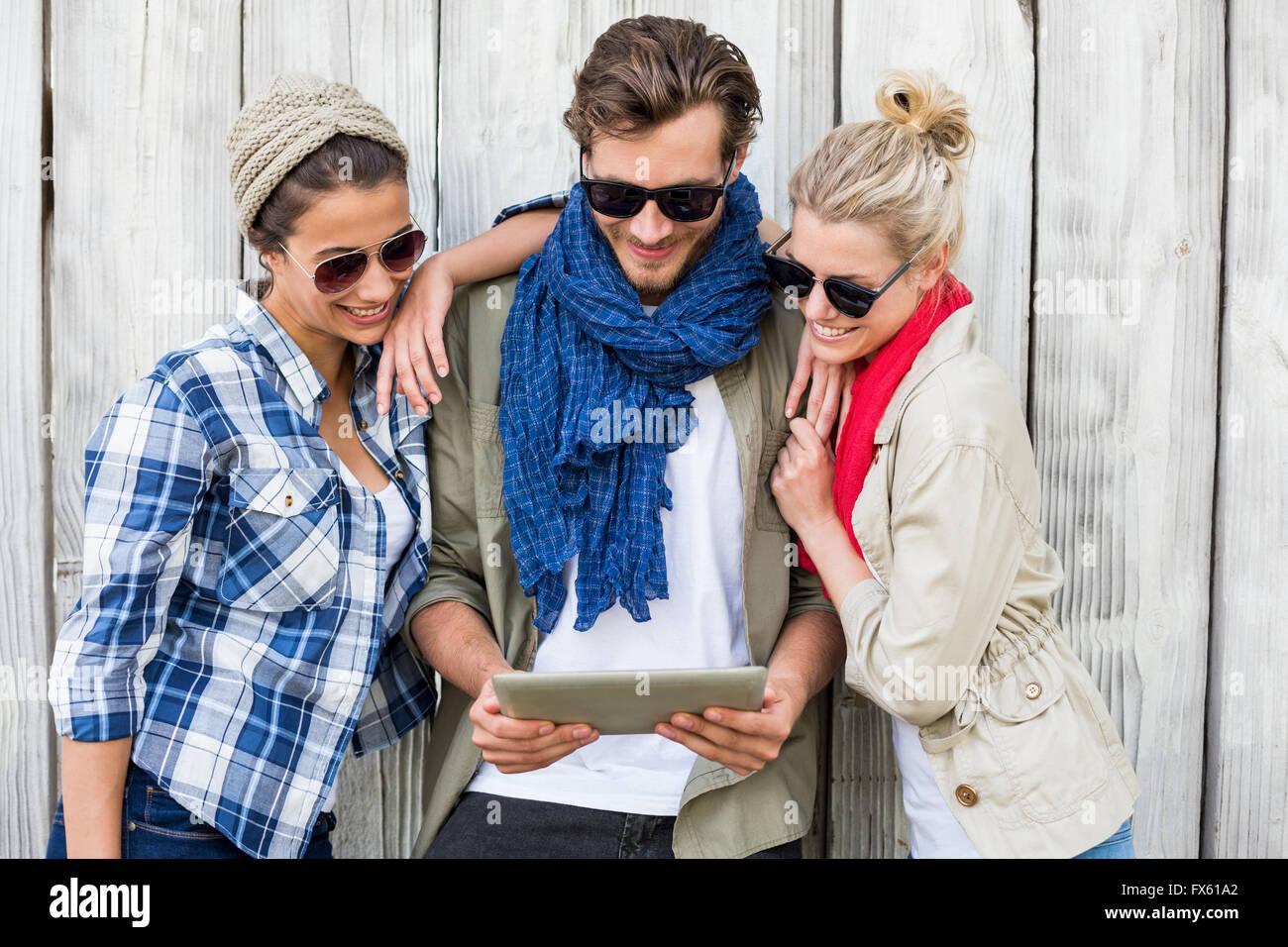 Friends using digital tablet - Stock Image