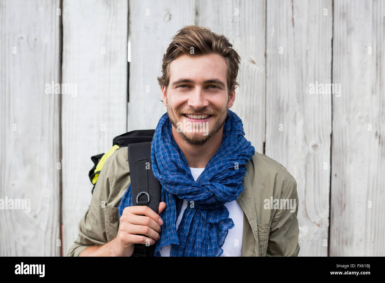 Young man carrying backpack - Stock Image
