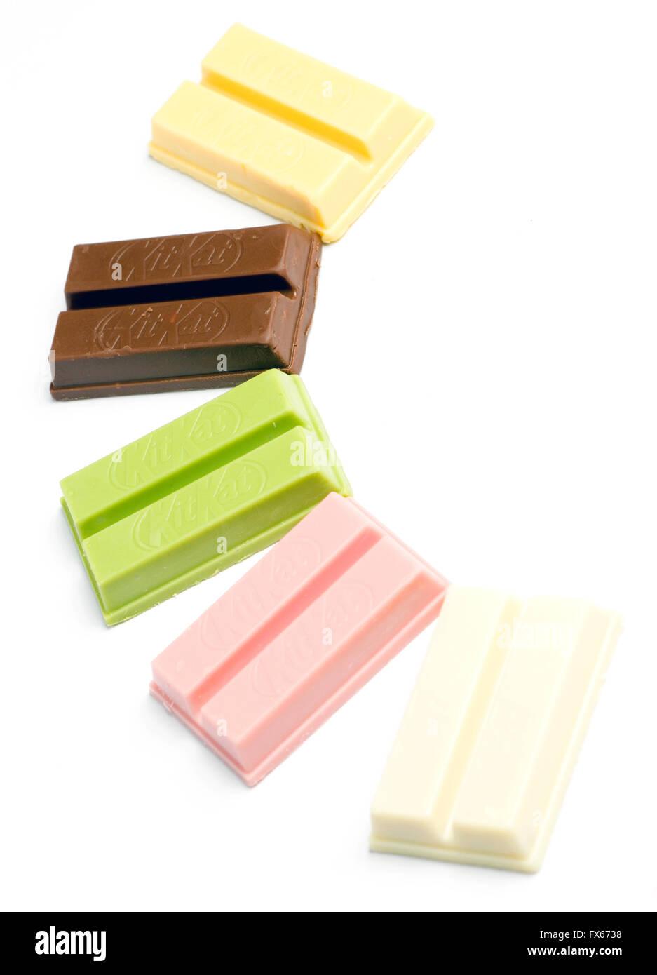 Variety of KitKat flavours from Japan. (sweet potato, red bean, green tea, raspberry, sake) Stock Photo