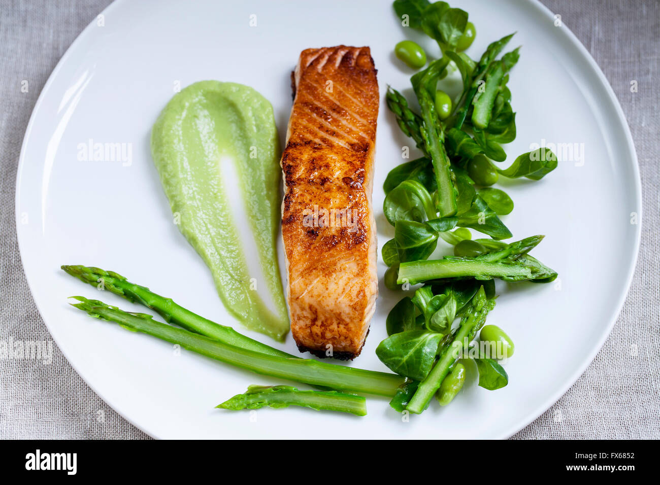 Salmon, lamb lettuce, asparagus and soy beans - Stock Image