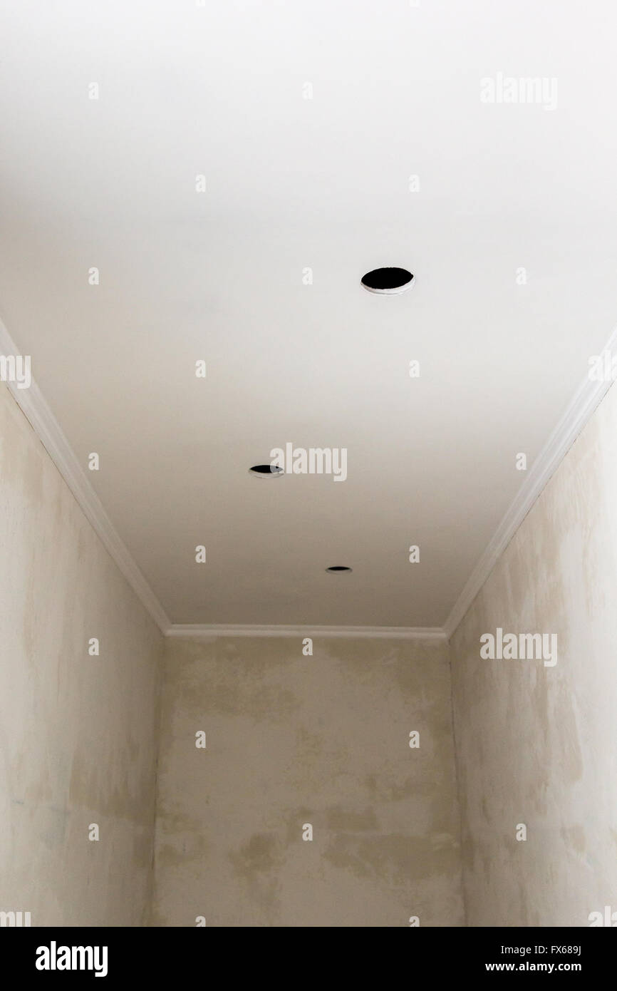 holes and wiring for ceiling spotlight unfinished work stock photo rh alamy com wiring ceiling downlights uk wiring ceiling downlights uk