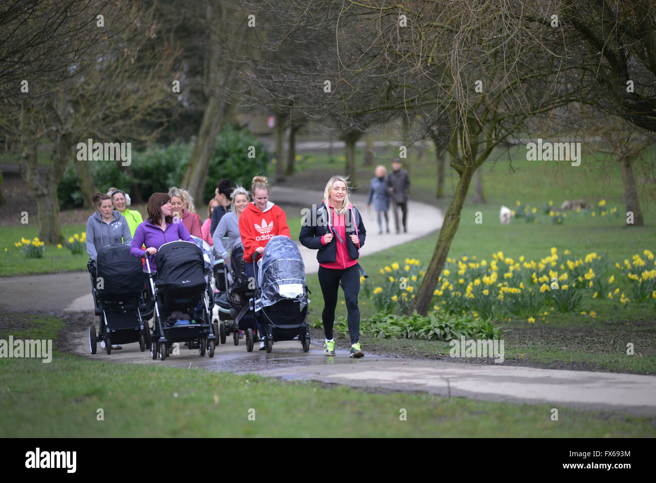 New mums exercising and keeping fit in the park. - Stock Image