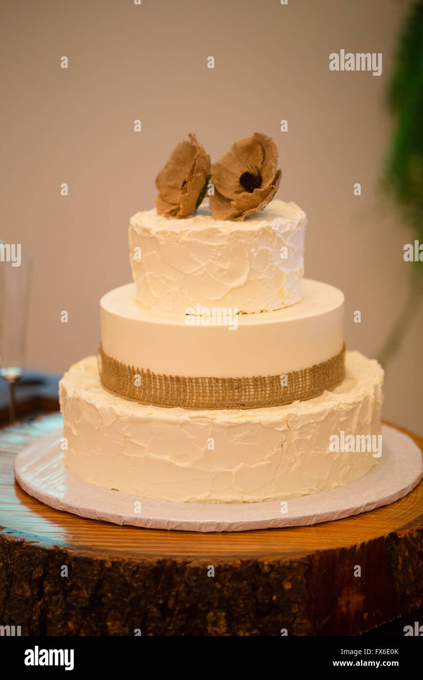 Wood round holding a wedding cake for the bride and groom to cut at ...
