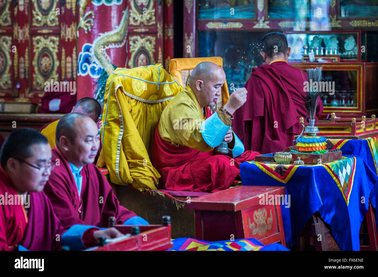 Buddhist monks in prayer - Stock Image