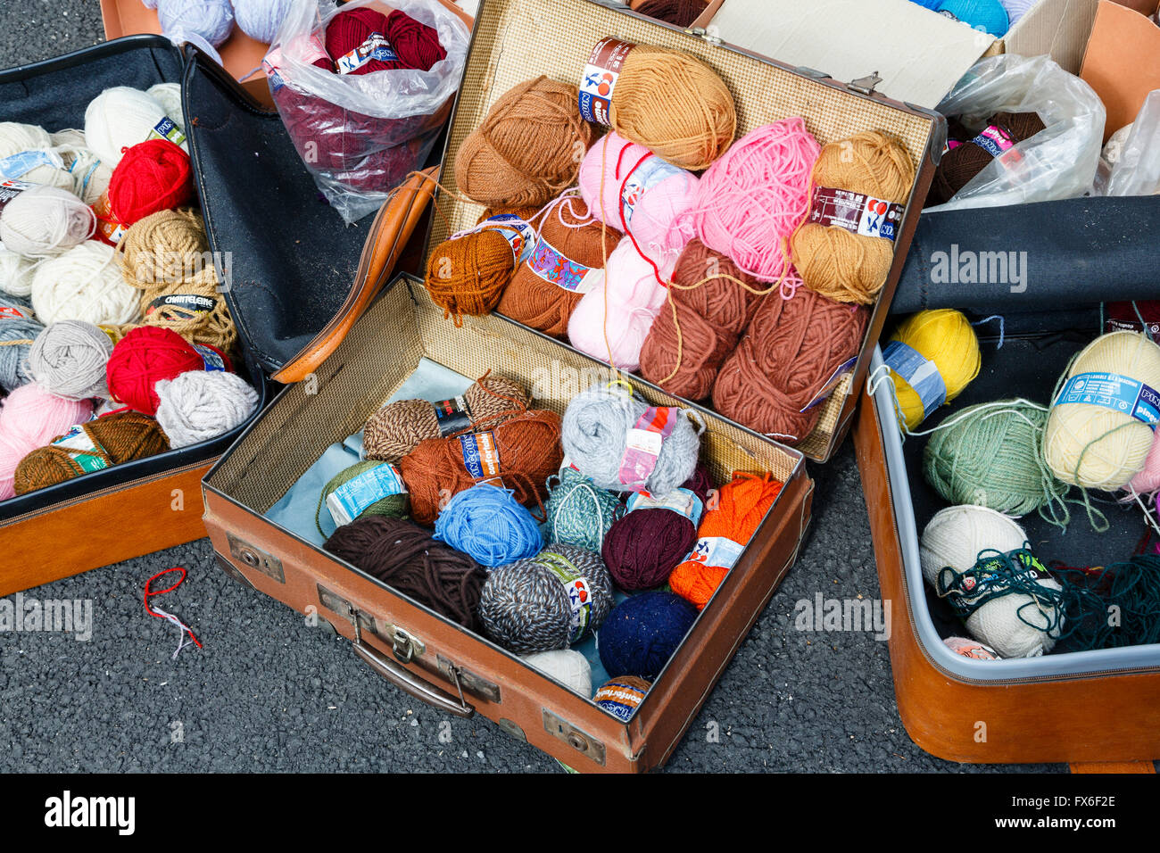 Balls of wool for sale at a vide-grenier in the village of Allègre, Haute-Loire, France - Stock Image