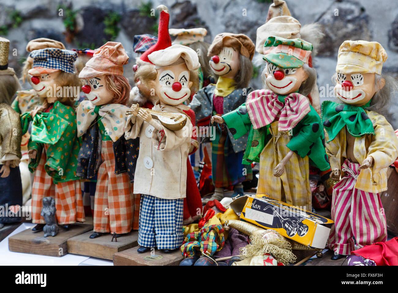 Clown dolls on sale at a vide-grenier in Allègre, Haute