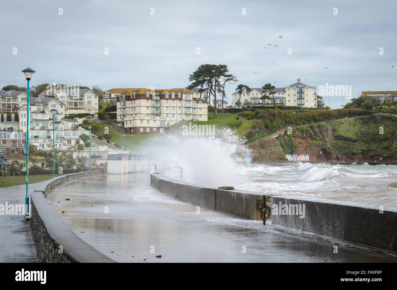 Waves crashing over the sea-front at Goodrington in Devon - Stock Image