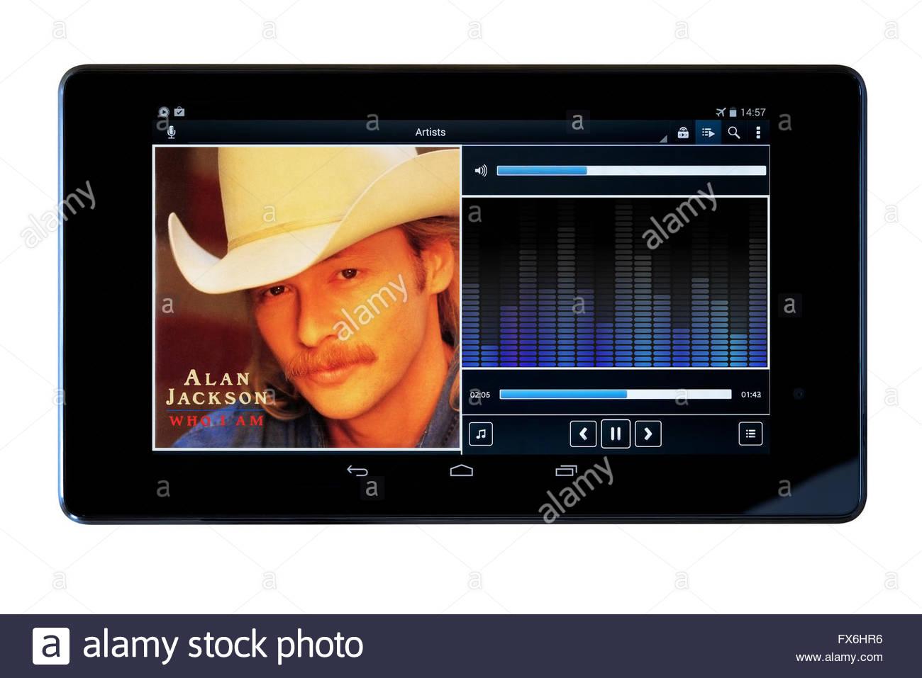 Alan Jackson Who Am I album, MP3 album art on PC tablet, England - Stock Image