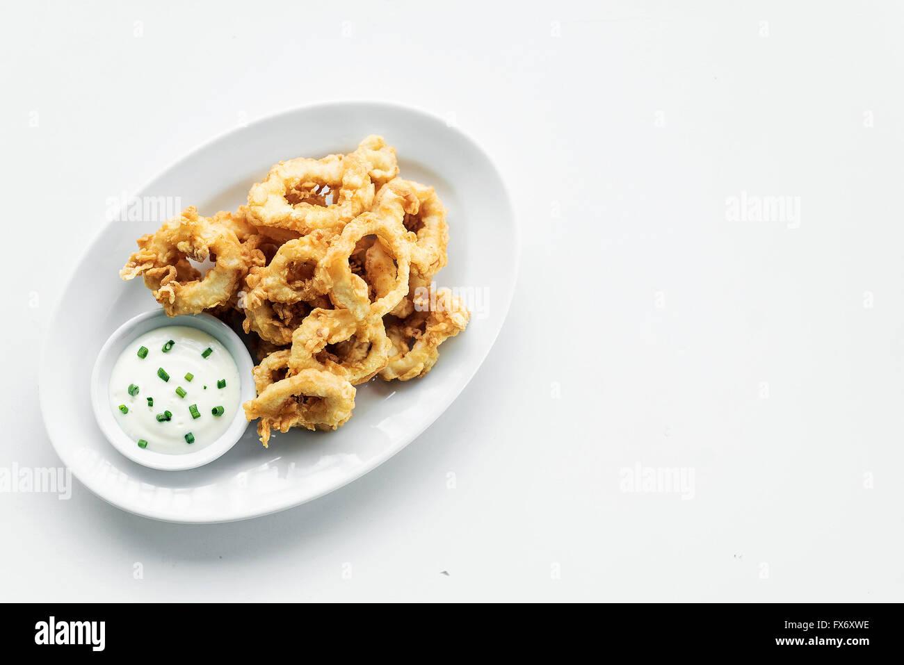 traditional spanish fried calamari squid rings tapas with aioli garlic sauce - Stock Image