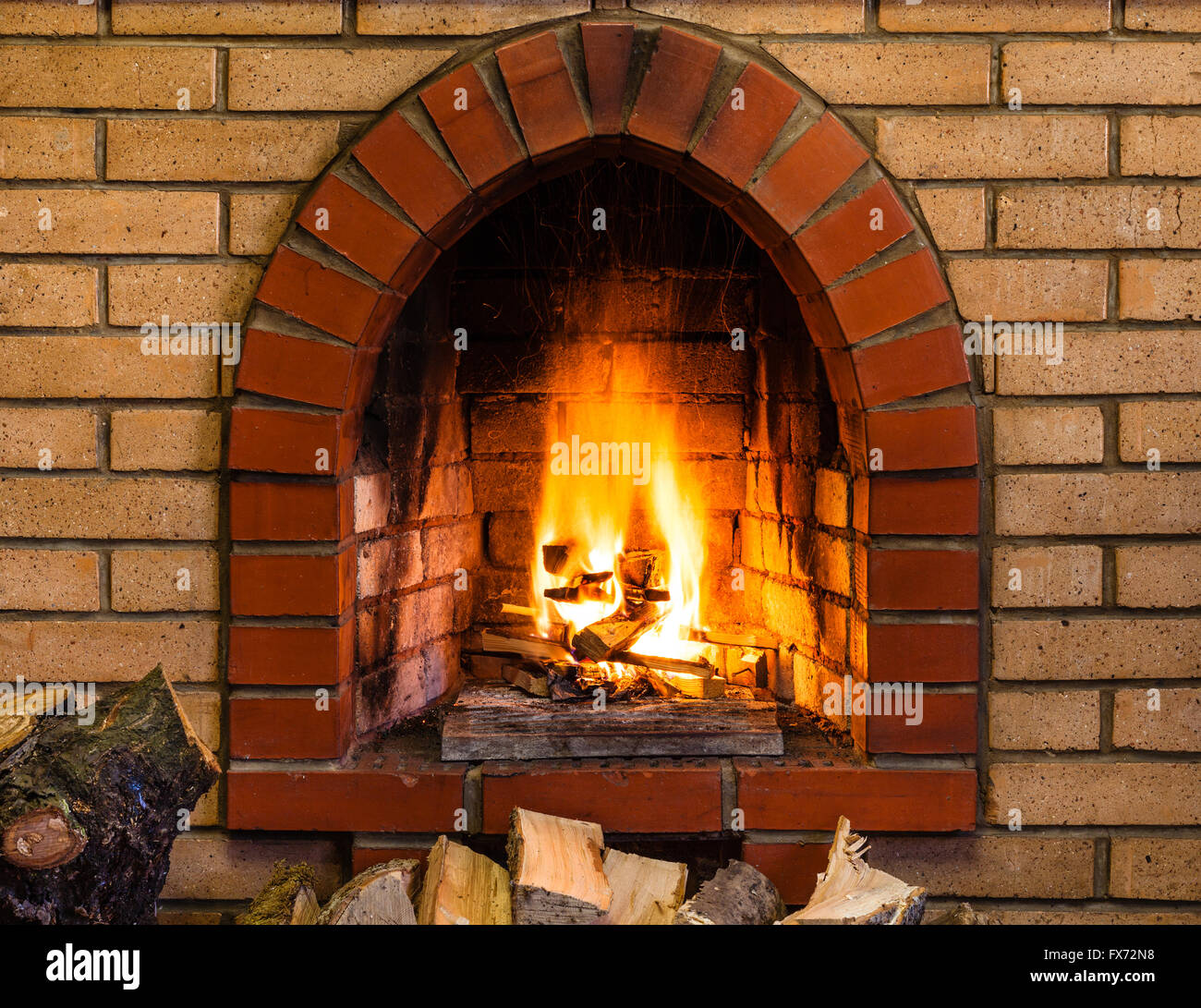 open fire in indoor brick fireplace in country cottage stock photo rh alamy com Outdoor Fire Brick for Fireplace Fire Brick for Fireplaces Firebox