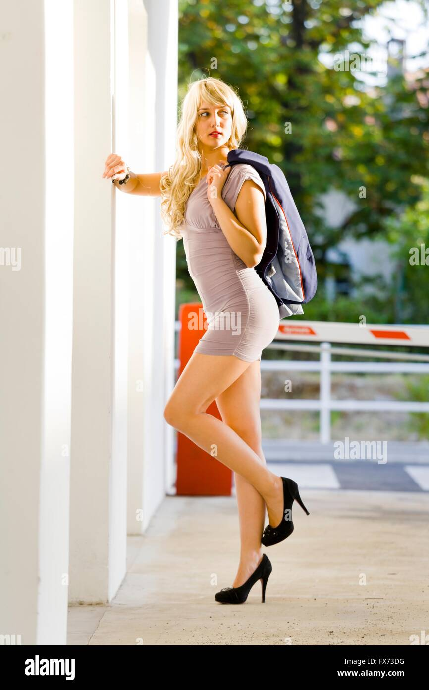 Blonde Woman In Short Dress And High Heels In Sunset Light
