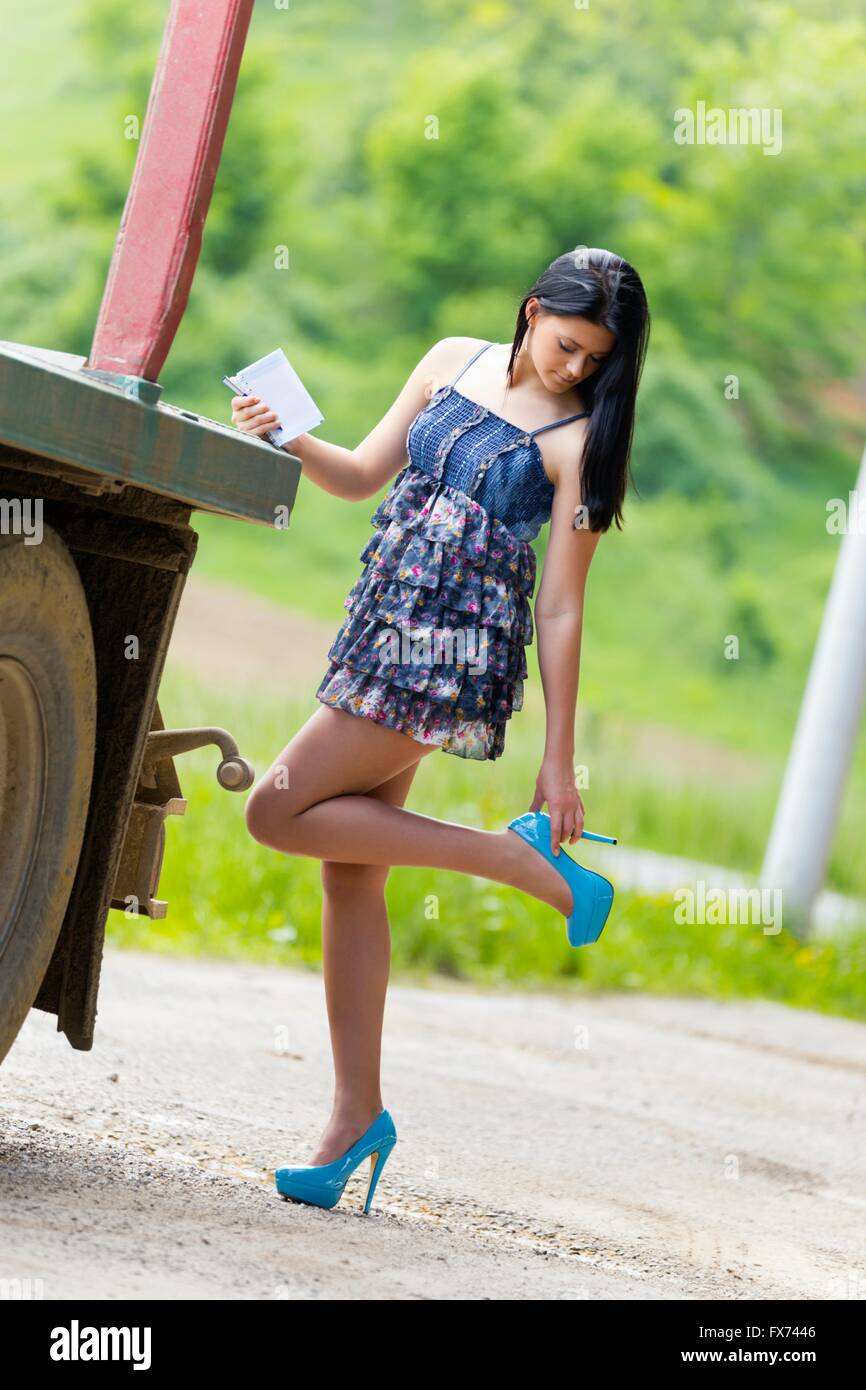 Teen girl and parked truck vehicle touching touch high