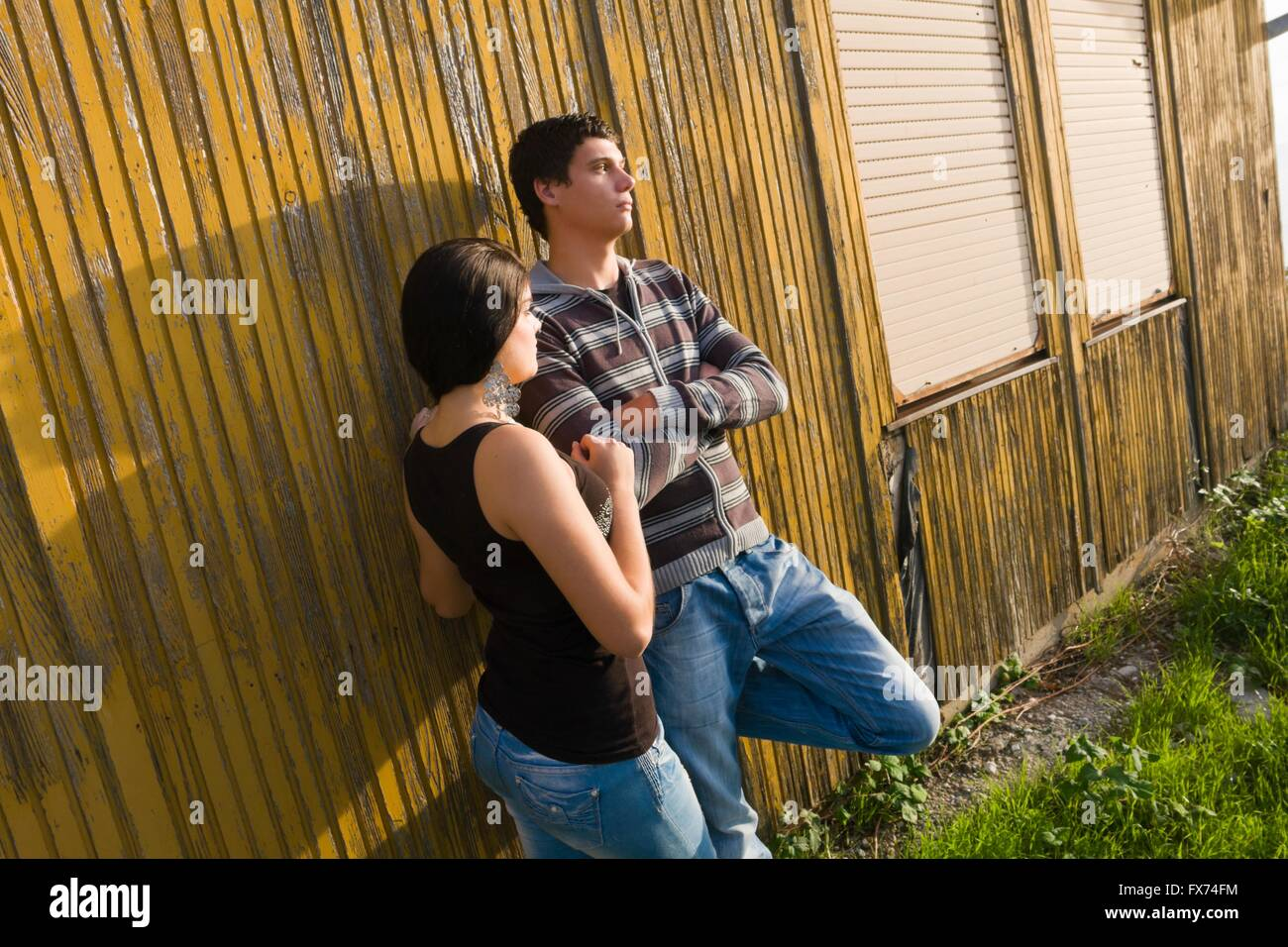 Teen girl and boy arguing deny refuse refusal negative feeling denied outdoors dispute disputing different diversity - Stock Image