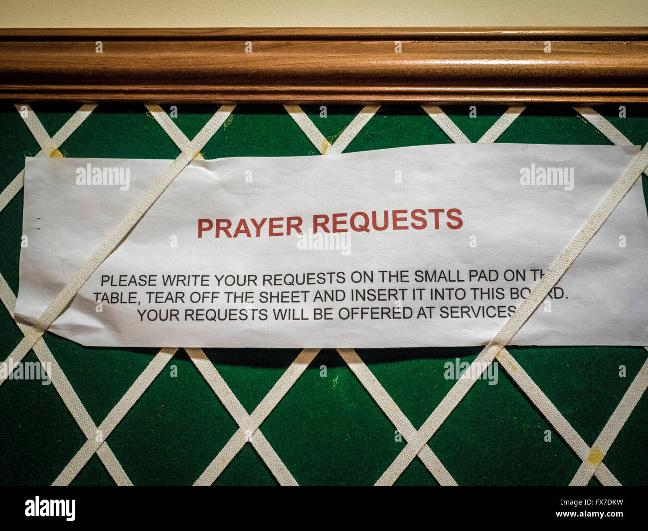 Prayer requests notice on noticeboard in church - Stock Image